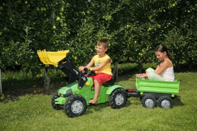 Children on the tractor in the garden